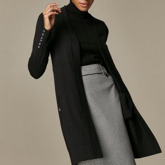 A Staple Black Cardigan With A Cosy Wool Mix Fabric. Its Classic Design And Flattering Fit Make It Perfect For Year-Round Layering, Whilst Its Thick Fabric Will Keep You Warm And Cosy. Wear Over A High Neck Jumper, Classic Checked Skirt And Pair With Ankle Boots For Perfect 9-5 Style. Cardigan Loose Long Sleeve Pull On Casual 39% Polyester, 33% Cotton, 17% Nylon, 11% Wool. Machine Washable.